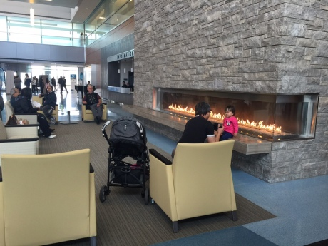 COZY AND WARM:  In the lobby you can relax near the fireplace while listening to live music from the nearby piano.  There is so much natural light here, depending on where you sit, you might need sunglasses.