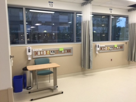 CURTAIN-FREE WINDOWS:  Electronic shades in the windows can be automatically controlled by the hospital, or manually controlled by patients.  Once a patient is assigned to an area, they control how much sunlight gets in.  In these small patient areas, one patient could be in full sunlight while his neighbor sits in darkness.